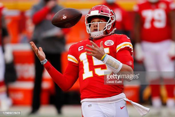 Quarterback Patrick Mahomes of the Kansas City Chiefs bobbles the snap in the second quarter of the AFC Divisional Playoff game against the Cleveland...