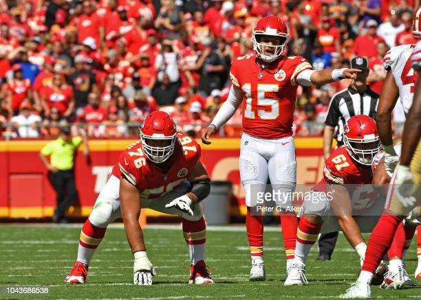 Quarterback Patrick Mahomes of the Kansas City Chiefs calls out the play as offensive tackle Laurent DuvernayTardif gets set on the line against the...