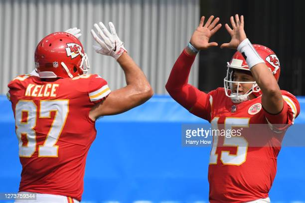 Quarterback Patrick Mahomes of the Kansas City Chiefs celebrates a touchdown by teammate tight end Travis Kelce against the Los Angeles Chargers...