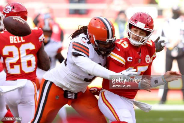 Quarterback Patrick Mahomes of the Kansas City Chiefs completes a shuffle pass before he is tackle by defensive end Adrian Clayborn of the Cleveland...