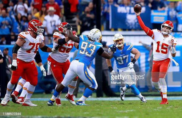 Quarterback Patrick Mahomes of the Kansas City Chiefs delivers a pass over defensive tackle Justin Jones of the Los Angeles Chargers during the game...