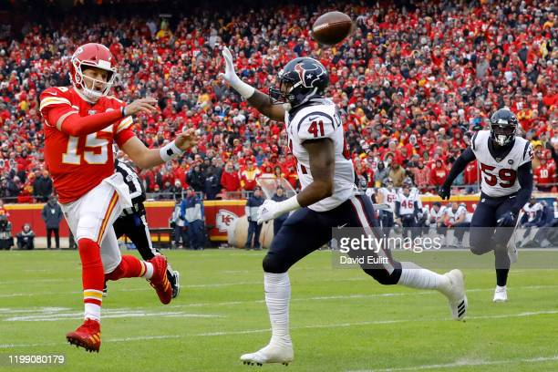 Quarterback Patrick Mahomes of the Kansas City Chiefs delivers a pass over Zach Cunningham of the Houston Texans during the AFC Divisional playoff...