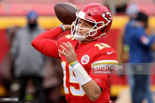 Quarterback Patrick Mahomes of the Kansas City Chiefs delivers a pass over the defense of the Cleveland Browns during the first quarter of the AFC...