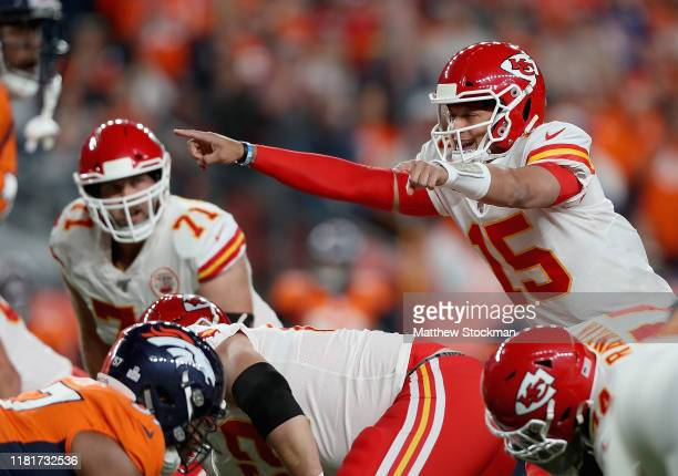 Quarterback Patrick Mahomes of the Kansas City Chiefs directs his team from the line of scrimmage against the defense of the Denver Broncos in the...