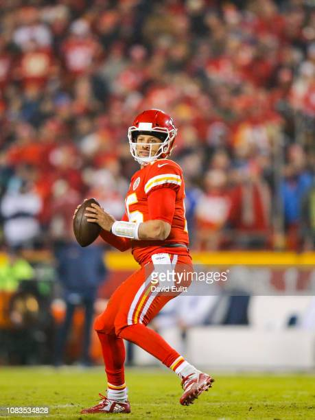 Quarterback Patrick Mahomes of the Kansas City Chiefs drops back to pass against the Los Angeles Chargers at Arrowhead Stadium on December 13 2018 in...