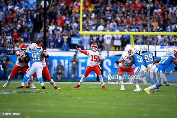 Quarterback Patrick Mahomes of the Kansas City Chiefs drops back to pass against the defense of the Los Angeles Chargers during the game at Estadio...