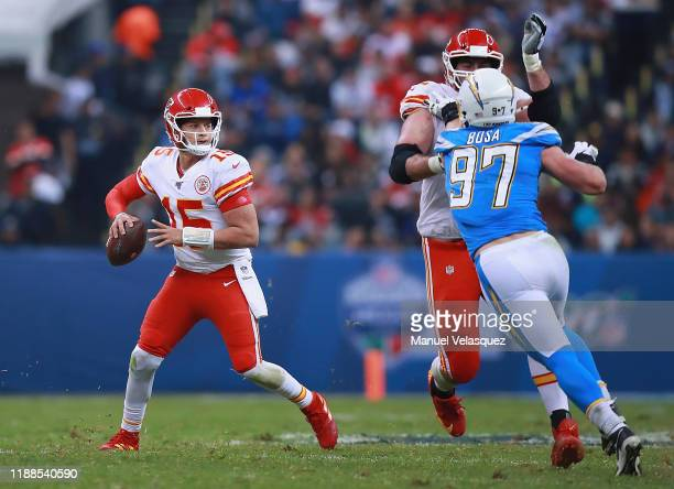 Quarterback Patrick Mahomes of the Kansas City Chiefs drops back to pass over defensive end Joey Bosa of the Los Angeles Chargers during the game at...