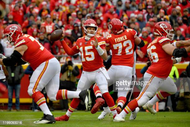 Quarterback Patrick Mahomes of the Kansas City Chiefs drops back to pass over the defense of the Houston Texans during the AFC Divisional playoff...
