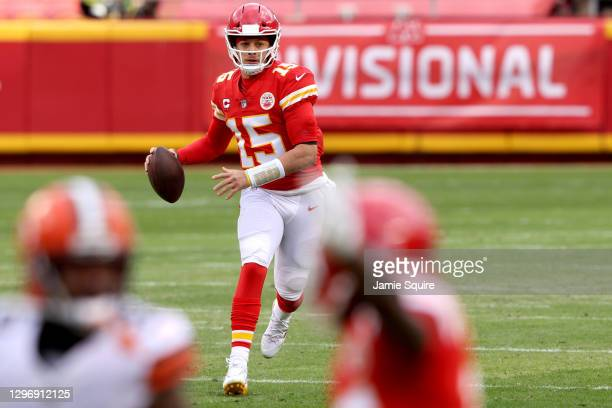 Quarterback Patrick Mahomes of the Kansas City Chiefs drops back to pass over the defense of the Cleveland Browns during the first quarter of the AFC...