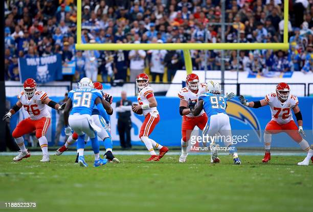 Quarterback Patrick Mahomes of the Kansas City Chiefs drops back tp pass against the defense of the Los Angeles Chargers during the game at Estadio...