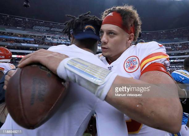 Quarterback Patrick Mahomes of the Kansas City Chiefs embraces a Los Angeles Chargers player after winning the game 2417 at Estadio Azteca on...