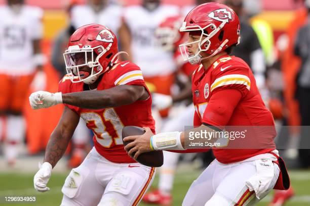 Quarterback Patrick Mahomes of the Kansas City Chiefs fakes a hand-off to running back Darrel Williams of the Kansas City Chiefs during the AFC...