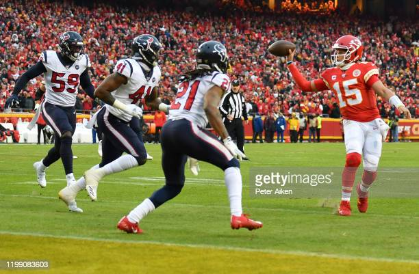 Quarterback Patrick Mahomes of the Kansas City Chiefs flips a pass to Travis Kelce over the defense of the Houston Texans in the second quarter of...