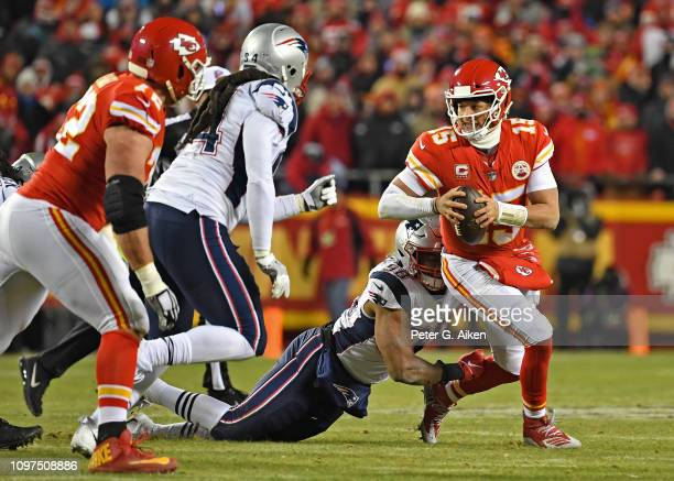 Quarterback Patrick Mahomes of the Kansas City Chiefs gets sacked by defensive end Trey Flowers of the New England Patriots during the first half of...