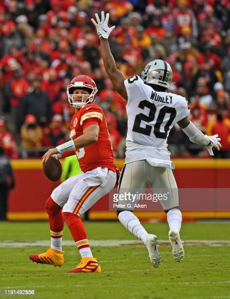 Quarterback Patrick Mahomes of the Kansas City Chiefs gets set to throw a pass against pressure from cornerback Daryl Worley of the Oakland Raiders...