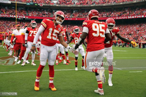 Quarterback Patrick Mahomes of the Kansas City Chiefs greets defensive end Chris Jones during pregame introductions prior to the game against the...