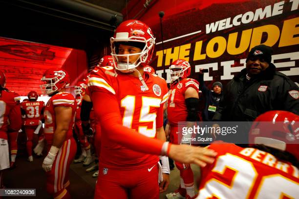 Quarterback Patrick Mahomes of the Kansas City Chiefs greets teammates in the tunnel prior to the game against the Los Angeles Chargers at Arrowhead...