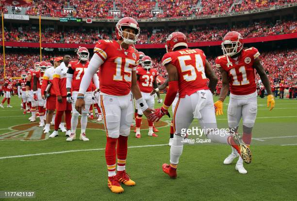 Quarterback Patrick Mahomes of the Kansas City Chiefs greets outside linebacker Damien Wilson during pregame introductions prior to the game against...