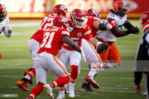 Quarterback Patrick Mahomes of the Kansas City Chiefs hands-off the football to running back Darrel Williams during the first quarter of the AFC...