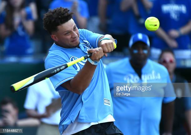 Quarterback Patrick Mahomes of the Kansas City Chiefs hits a ball during the Big Slick celebrity softball game prior to a game between the Chicago...