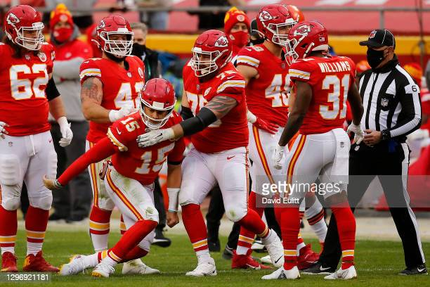 Quarterback Patrick Mahomes of the Kansas City Chiefs is assisted by offensive tackle Mike Remmers after an injury from a sack that would remove...