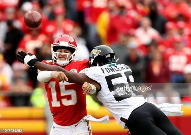 Quarterback Patrick Mahomes of the Kansas City Chiefs is hit by Dante Fowler of the Jacksonville Jaguars during the game at Arrowhead Stadium on...
