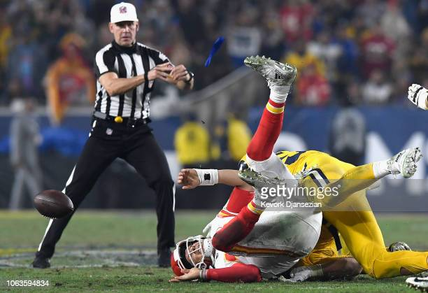 Quarterback Patrick Mahomes of the Kansas City Chiefs is sacked and fumbles the ball during the third quarter of the game against the Los Angeles...