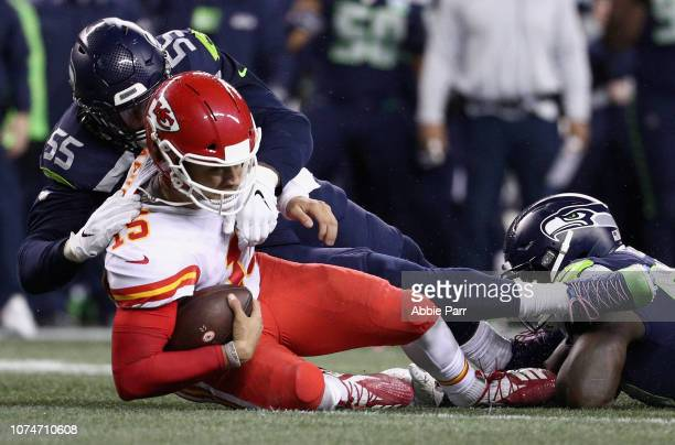 Quarterback Patrick Mahomes of the Kansas City Chiefs is sacked by Frank Clark of the Seattle Seahawks during the fourth quarter of the game at...