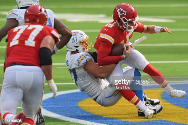 Quarterback Patrick Mahomes of the Kansas City Chiefs is sacked by defensive end Joey Bosa of the Los Angeles Chargers during the third quarter at...