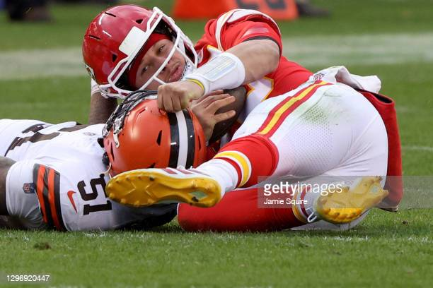 Quarterback Patrick Mahomes of the Kansas City Chiefs is sacked by outside linebacker Mack Wilson of the Cleveland Browns, Mahomes is injured on the...