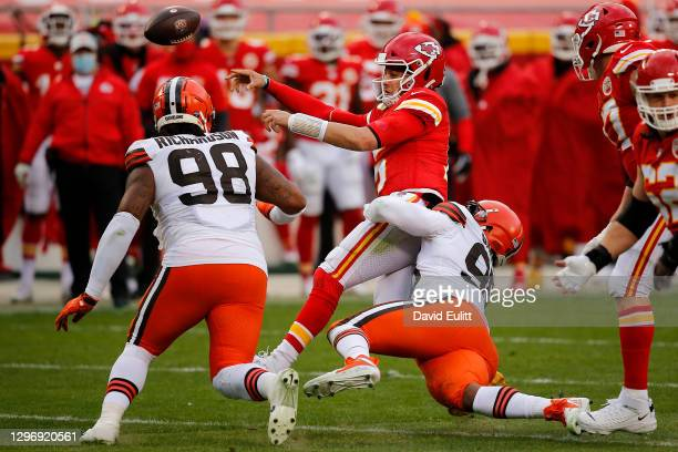 Quarterback Patrick Mahomes of the Kansas City Chiefs is sacked by defensive end Myles Garrett of the Cleveland Browns during the third quarter of...