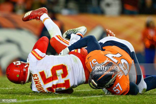 Quarterback Patrick Mahomes of the Kansas City Chiefs is sacked by defensive end DeMarcus Walker of the Denver Broncos at Sports Authority Field at...