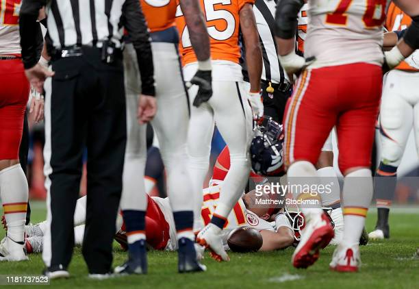 Quarterback Patrick Mahomes of the Kansas City Chiefs lays on the field after an injury in the first half against the Denver Broncos in the game at...