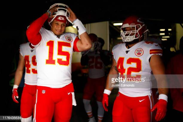 quarterback Patrick Mahomes of the Kansas City Chiefs leads his team to the field including safety Daniel Sorensen and Anthony Sherman before a game...