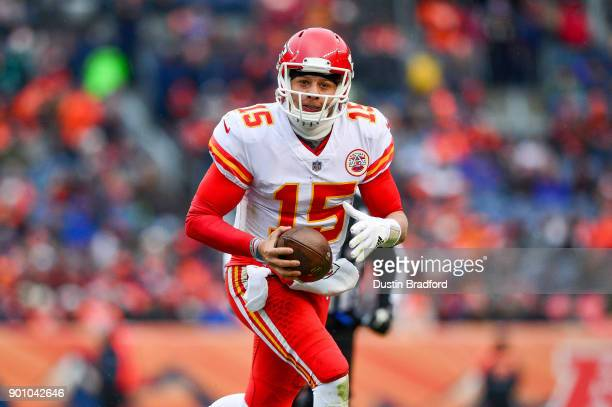 Quarterback Patrick Mahomes of the Kansas City Chiefs looks for a receiver downfield against the Denver Broncos at Sports Authority Field at Mile...