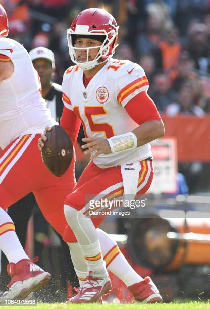 Quarterback Patrick Mahomes of the Kansas City Chiefs looks for an open receiver in the second quarter of a game against the Cleveland Browns on...