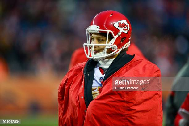 Quarterback Patrick Mahomes of the Kansas City Chiefs looks on from the sideline during a game against the Denver Broncos at Sports Authority Field...