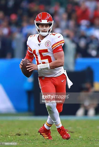 Quarterback Patrick Mahomes of the Kansas City Chiefs looks to pass against the defense of the Los Angeles Chargers during the game at Estadio Azteca...