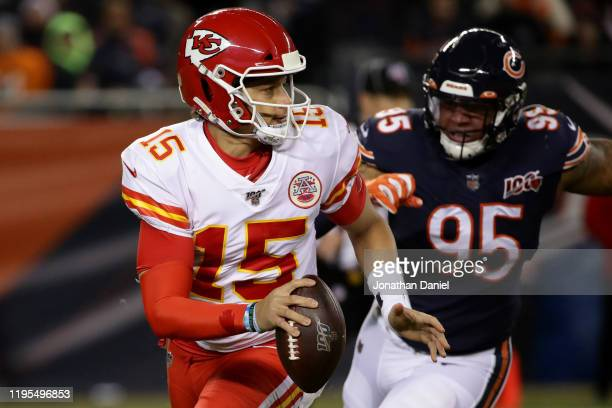 Quarterback Patrick Mahomes of the Kansas City Chiefs looks to pass against defensive end Roy RobertsonHarris of the Chicago Bears in the second...