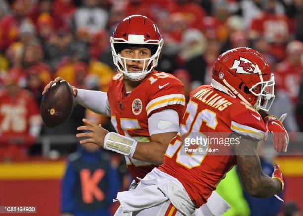 Quarterback Patrick Mahomes of the Kansas City Chiefs looks to throw a pass to the outside after faking a handoff to running back Damien Williams...