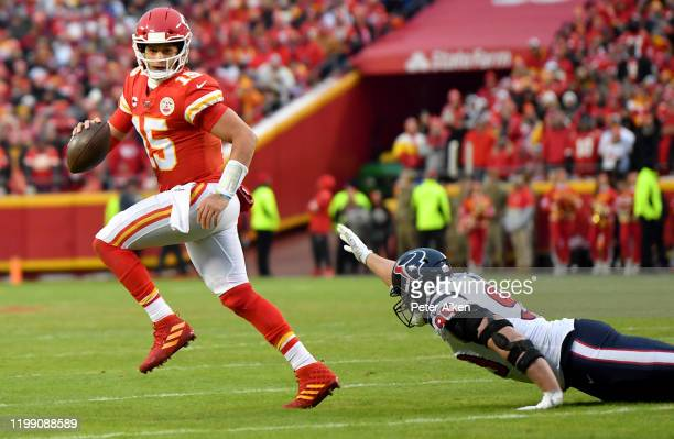 Quarterback Patrick Mahomes of the Kansas City Chiefs out runs JJ Watt of the Houston Texans during the AFC Divisional playoff game at Arrowhead...