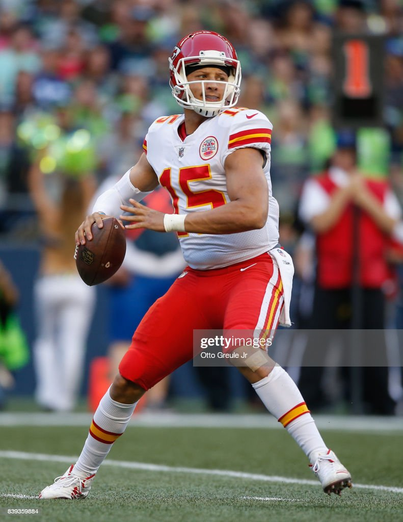 Quarterback Patrick Mahomes #15 of the Kansas City Chiefs passes against the Seattle Seahawks at CenturyLink Field on August 25, 2017 in Seattle, Washington.
