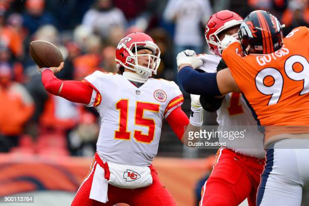 Quarterback Patrick Mahomes of the Kansas City Chiefs passes against the Denver Broncos in the first quarter of a game at Sports Authority Field at...