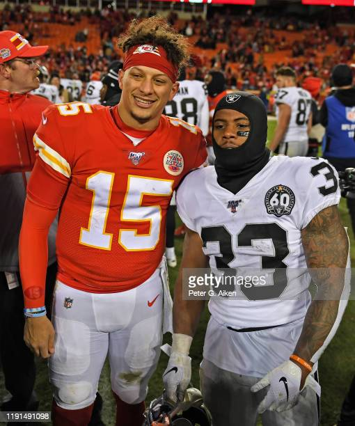 Quarterback Patrick Mahomes of the Kansas City Chiefs poses for a photo with running back DeAndre Washington of the Oakland Raiders, following the...