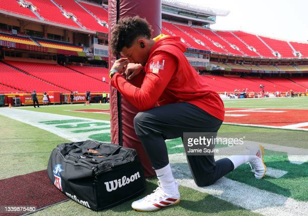 Quarterback Patrick Mahomes of the Kansas City Chiefs prays prior to warming up for the game against the Cleveland Browns at Arrowhead Stadium on...