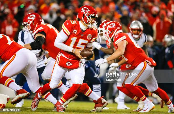 Quarterback Patrick Mahomes of the Kansas City Chiefs prepares to hand the football off during the AFC Championship Game against the New England...