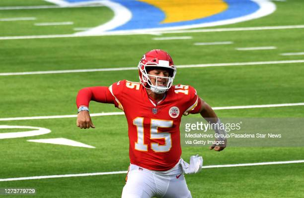 quarterback Patrick Mahomes of the Kansas City Chiefs reacts after throwing a touchdown pass to wide receiver Tyreek Hill against the Los Angeles...