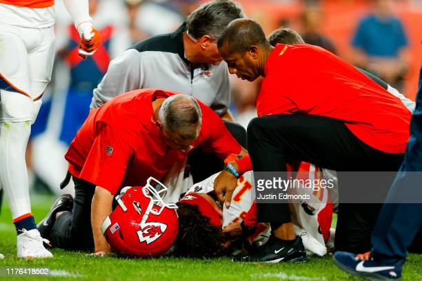 Quarterback Patrick Mahomes of the Kansas City Chiefs reacts after getting injured on a play during the second quarter against the Denver Broncos at...