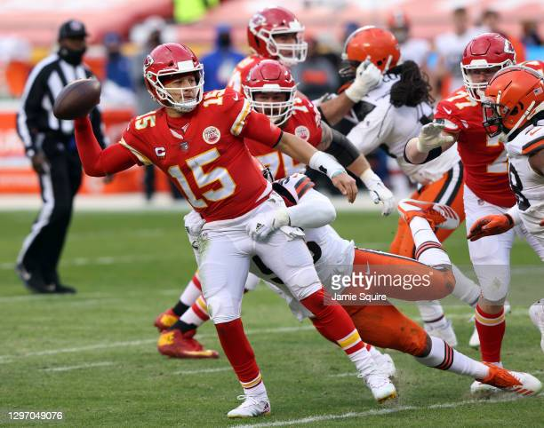 Quarterback Patrick Mahomes of the Kansas City Chiefs releases the ball as defensive end Myles Garrett of the Cleveland Browns tackles during the AFC...