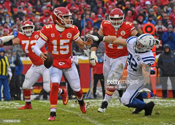Quarterback Patrick Mahomes of the Kansas City Chiefs rolls on on a pass play against defensive end Margus Hunt of the Indianapolis Colts during the...